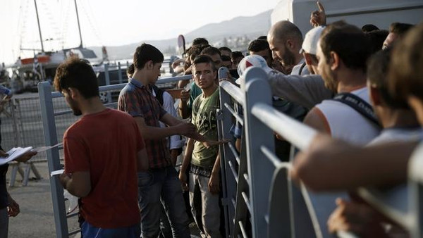 "Syrian refugees go through passport control before boarding the passenger ship ""Eleftherios Venizelos"" at the port on the Greek island of Kos, August 16, 2015. The vessel will house more than 2500 refugees and migrants who entered the country from theTurkish coast and will be used as a registration center for migrants.The United Nations refugee agency (UNHCR) called on Greece to take control of the ""total chaos"" on Mediterranean islands, where thousands of migrants have landed. About 124,000 have arrived this year by sea, many via Turkey, according to Vincent Cochetel, UNHCR director for Europe. REUTERS/Alkis Konstantinidis"